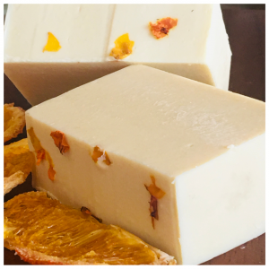 A bar of natural goat's milk soap with orange essential oils